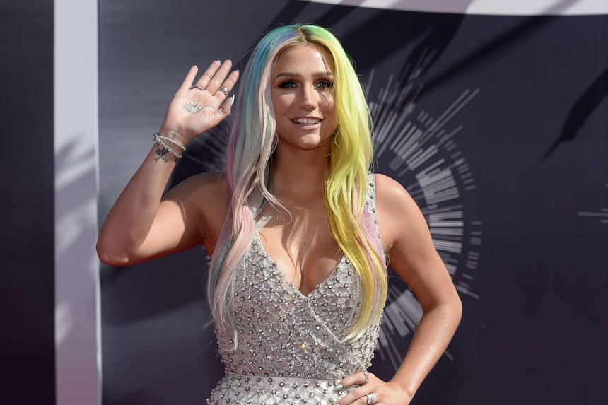 Singer Kesha arrives at the 2014 MTV Music Video Awards in Inglewood, California in this Aug 24, 2014 file photo.