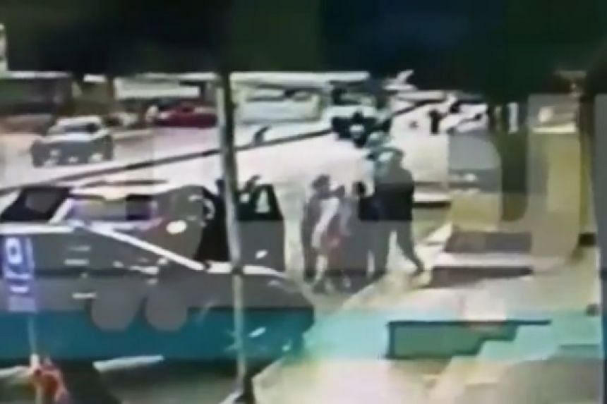 A screenshot from a grainy video shown on Lebanese TV, said to show the moment the mother tried to get her children back.