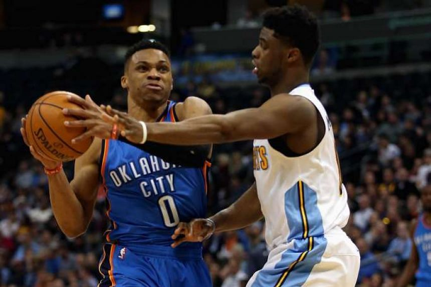 Russell Westbrook (left) of the Oklahoma City Thunder drives to the basket against Emmanuel Mudiay of the Denver Nuggets on April 5, 2016.