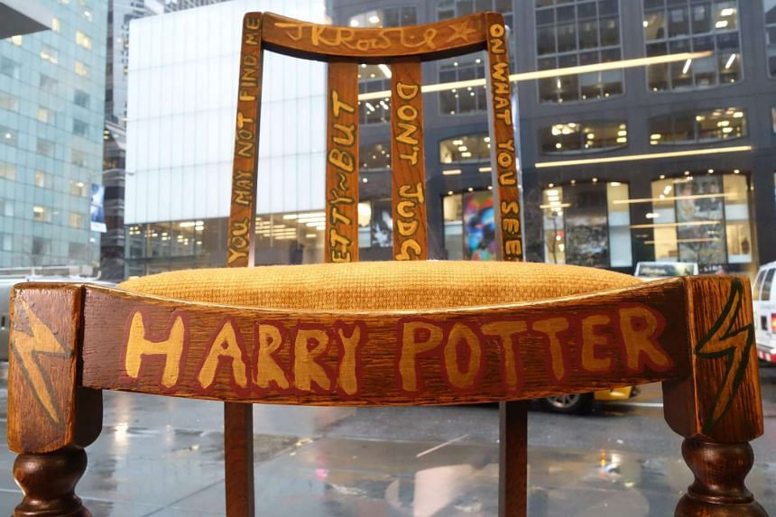 The chair used, and later decorated, by Harry Potter author JK Rowling on display at Heritage Auctions in New York.