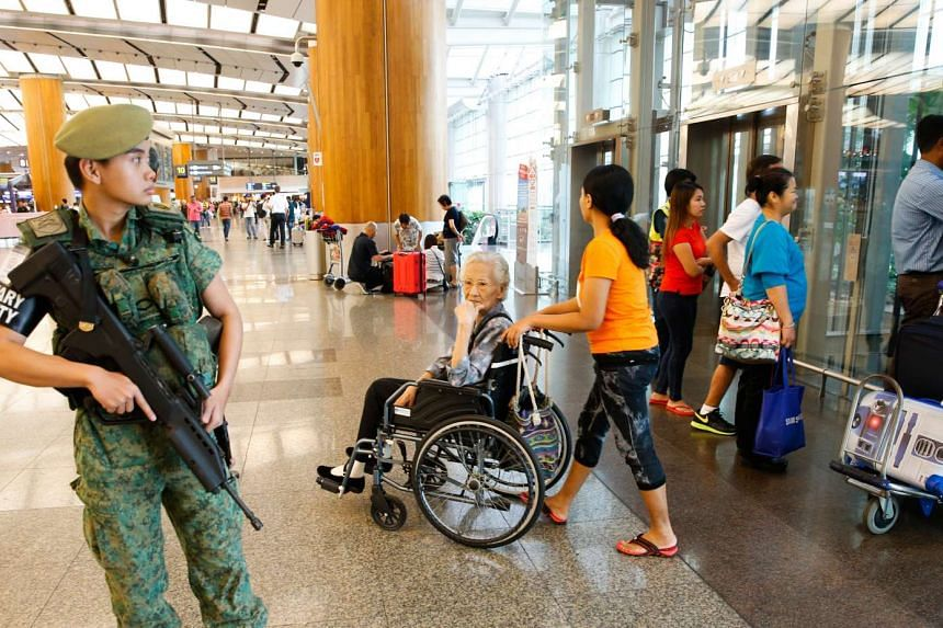 Military Security officer on patrol at Changi Airport Terminal 2, on March 23, 2016.