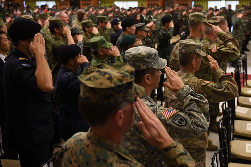 Philippine and US soldiers, along with visiting military attache members, at the opening ceremony of the annual joint 11-day Balikatan (Shoulder-to-Shoulder) military exercise in Manila, on April 4, 2016.