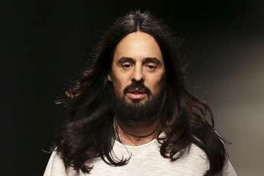 Creative director Alessandro Michele (above), who embraces the androgynous look in his collections, will present Gucci's unified collection at the brand's new Milan headquarters at Via Mecenate next year.