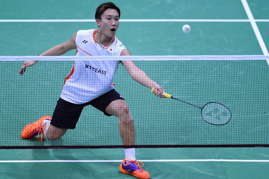 Japan's Kento Momota plays a shot during his match against China's Xue Song at the Yonex-Sunrise India Open in New Delhi on April 2, 2016.