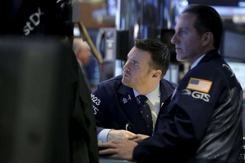 Traders work on the floor of the New York Stock Exchange, April 6, 2016.