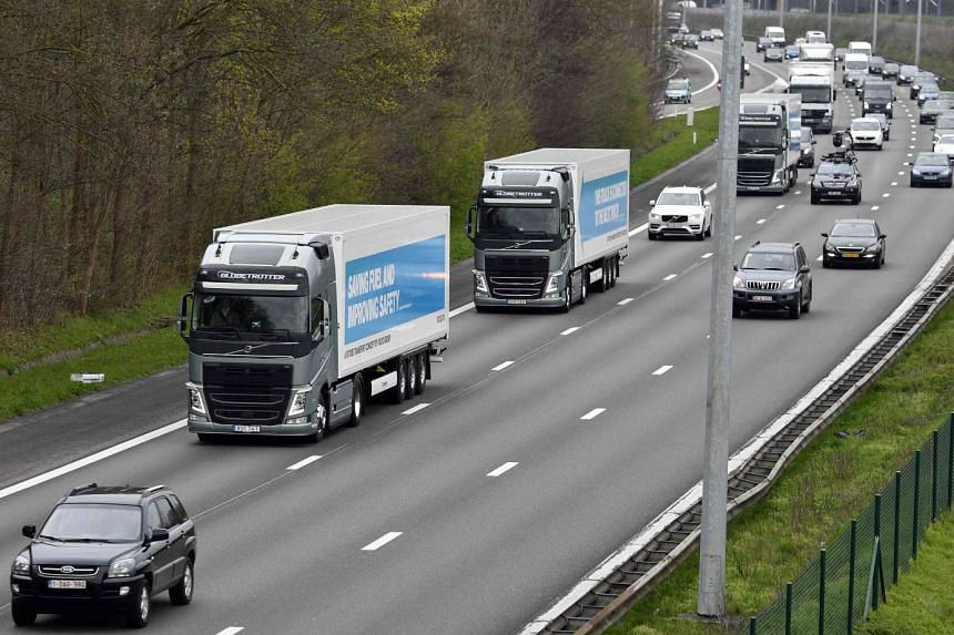 "Semi-automated trucks are driven on a highway in Belgium as part of the ""EU Truck Platooning Challenge 2016""."