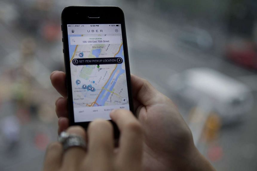 The Uber car service application is displayed on an iPhone in New York.