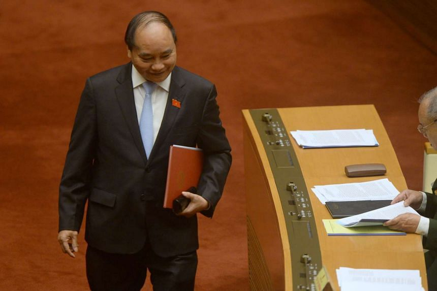 Deputy Prime Minister Nguyen Xuan Phuc at the opening of the last session of the outgoing parliament in Hanoi, on March 21, 2016.