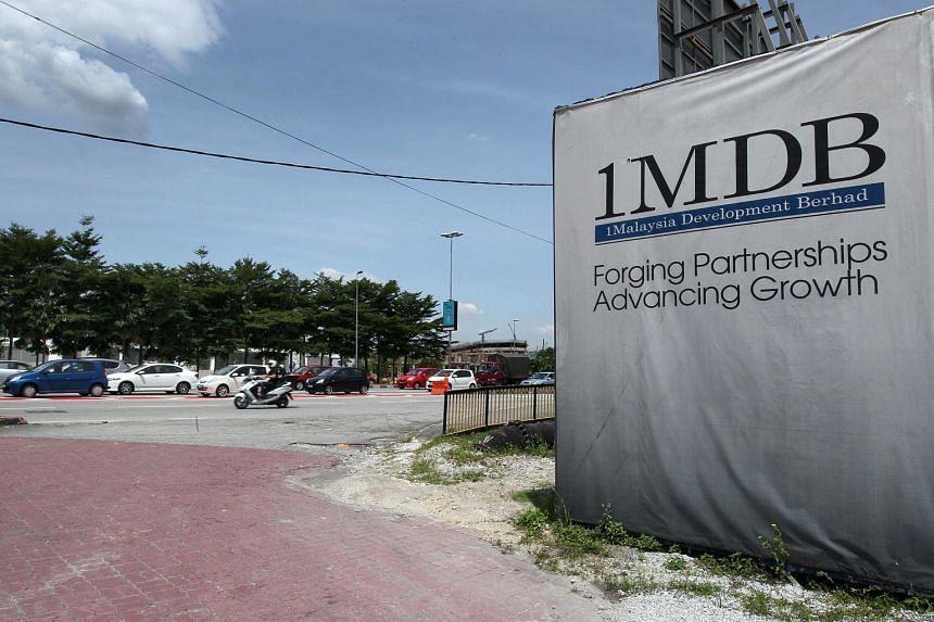 The 1Malaysia Development Berhad (1MDB) sign is displayed at the site of the Tun Razak Exchange (TRX) project in Kuala Lumpur, Malaysia.