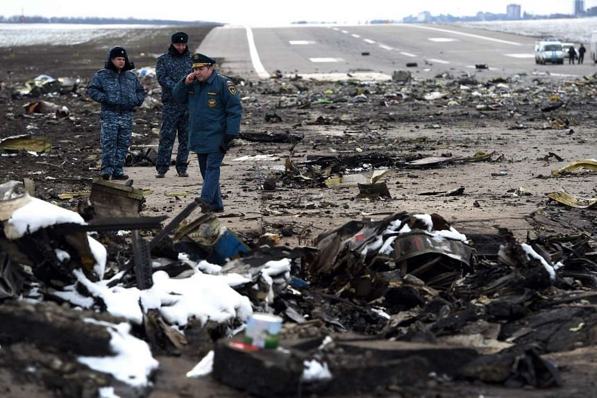 Russian Emergency Ministry rescuers examine the wreckage of the crashed flydubai airplane at the Rostov-on-Don airport on March 20, 2016.
