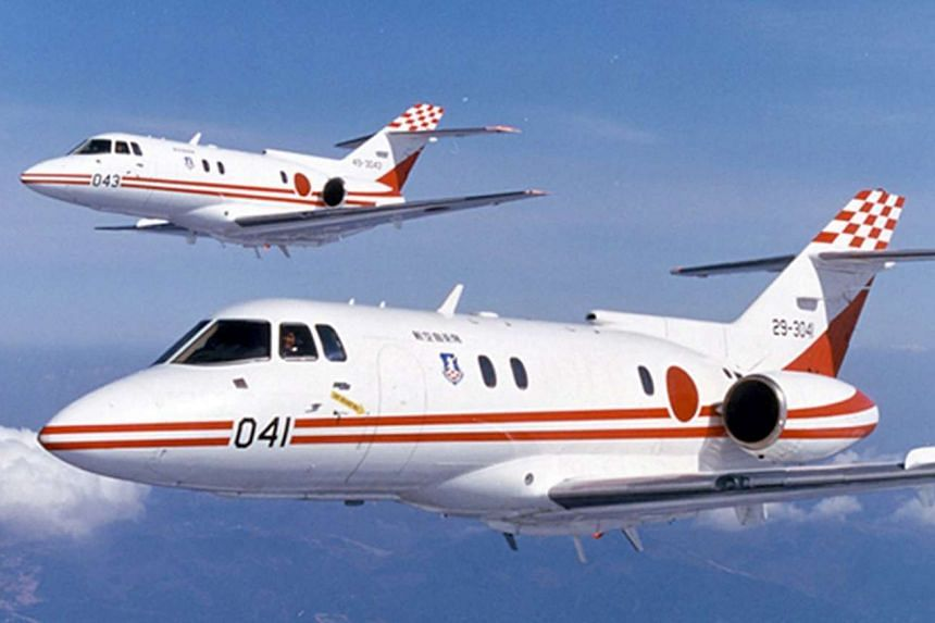 A photo provided by Japan Air Self-Defense Force (JASDF) that shows two U-125 jets.