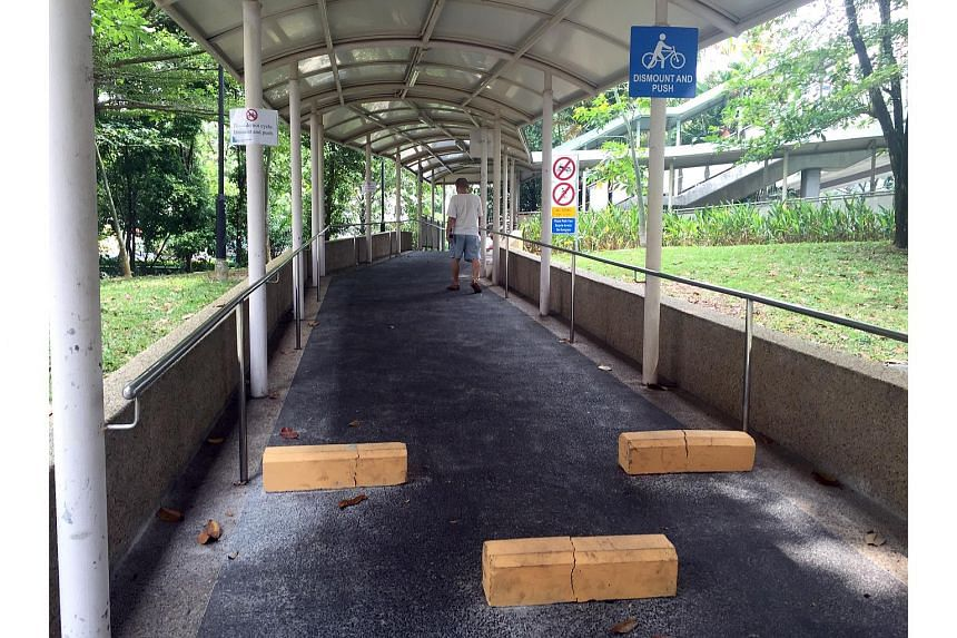 Barriers installed at the bottom of a ramp leading to an overhead bridge near Bedok North Block 106 to deter cyclists from speeding.