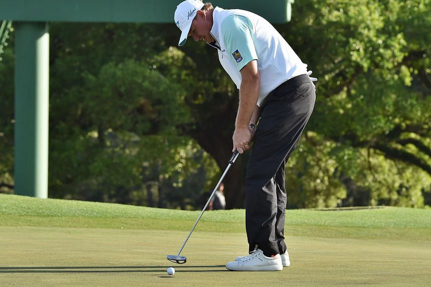 Ernie Els putts on the 18th green during Round 1 of the 80th Masters Golf Tournament at the Augusta National Golf Club on April 7, 2016.