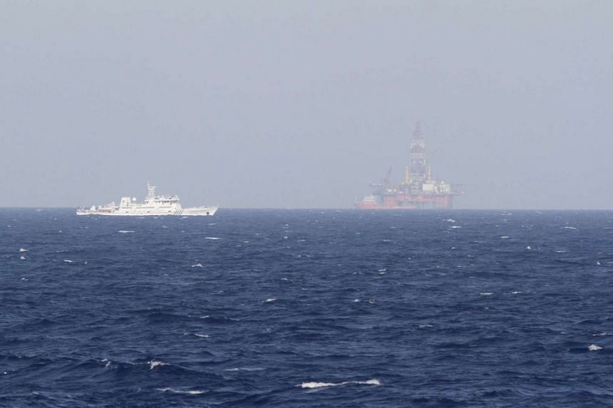 An oil rig (right) in the South China Sea, which China calls Haiyang Shiyou 981, and Vietnam refers to as Hai Duong 981, seen off the shore of Vietnam on May 14, 2014.