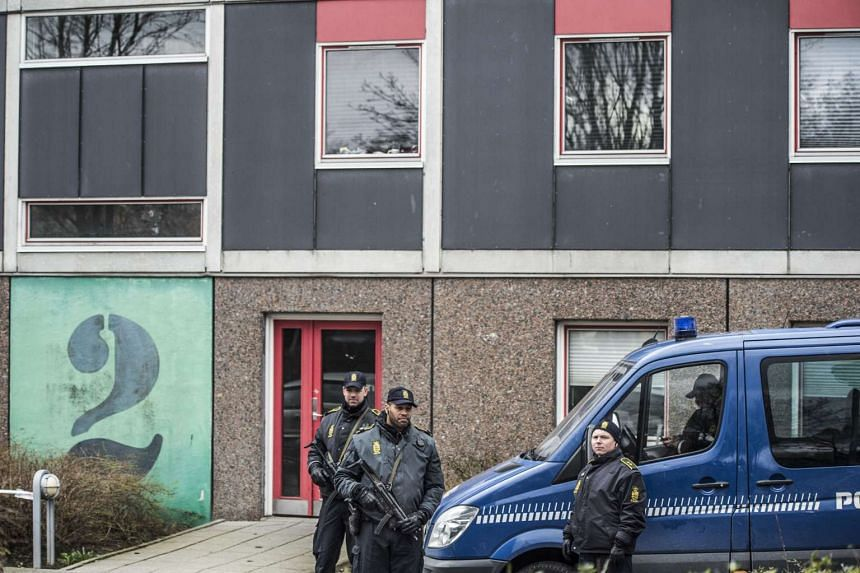 Danish police, in cooperation with the Police Intelligence Department, search an apartment block in Ishoej, south of Copenhagen, Denmark, on April 7, 2016.