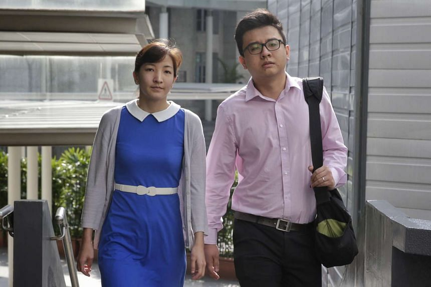 Yang Kaiheng and his wife Ai Takagi arriving at the State Courts on April 8, 2016.