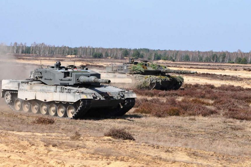 The Singapore Armed Forces' (SAF's) Leopard 2SG Main Battle Tank (MBT) (foreground) and Bundeswehr's Leopard 2A6 MBT participating in bilateral training.