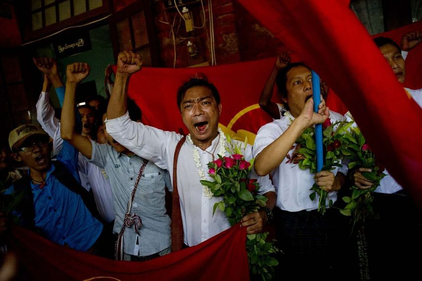 Student protesters shout slogans as they arrive for a hearing at their trial in Tharrawaddy town, Bago Region in Myanmar.