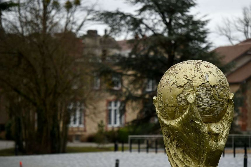 A replica of the FIFA World Cup Trophy outside the residence of France's national football team at the National Football Training Centre. PHOTO: AFP