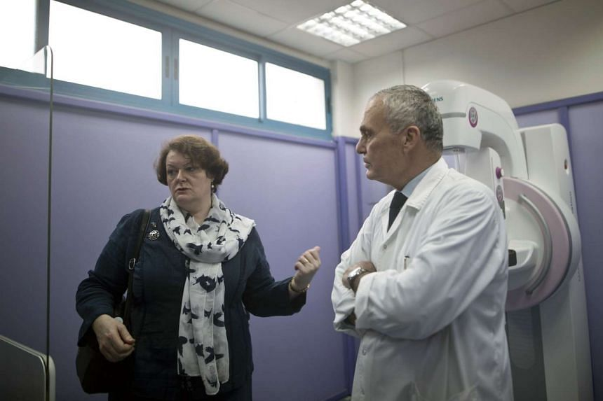 Dr Philippa Whitford (left), visits al-Ahli hospital with its medical director Doctor Maher Ayyad in Gaza City on April 5, 2016.