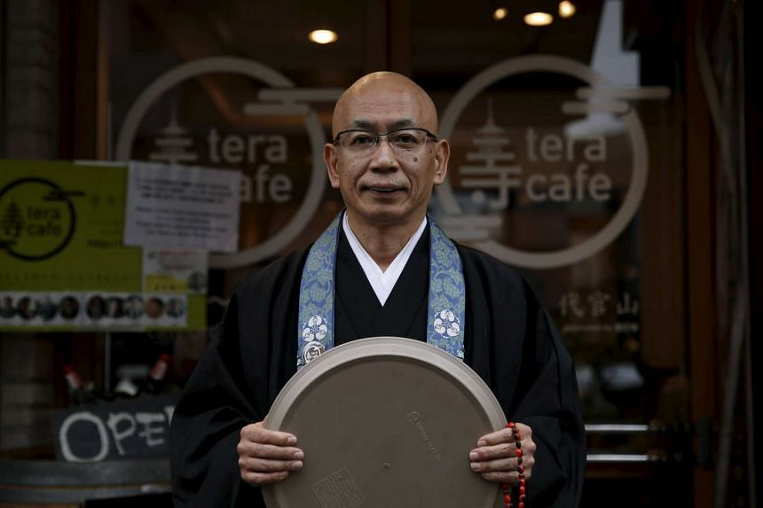 Buddhist monk and one of the on-site priests Shokyo Miura, posing for pictures outside Tera Cafe in Tokyo, Japan, on April 1, 2016.