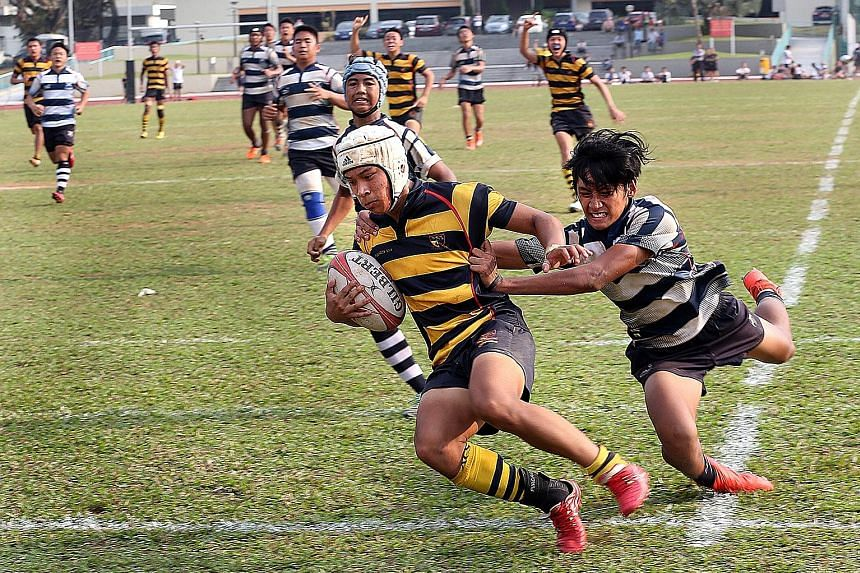 ACS(I) winger Benjamin Poey sprinting past the despairing dive of Saints' stand-off Miguel Erwin Besoro William to seal the title. His side were fired up for the showdown especially after Saints won 22-0 earlier. The Saints had a chance to take the l