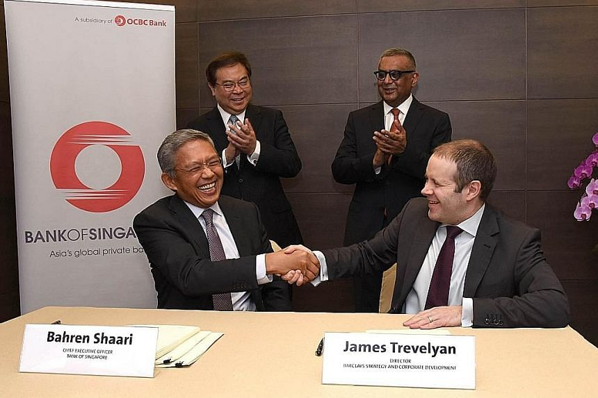Mr Shaari (seated, left), Bank of Singapore CEO, with Barclays strategy and corporate development director James Trevelyan at a signing ceremony in OCBC Centre yesterday. With them are OCBC Bank's group CEO Samuel Tsien and Barclays Wealth, Entrepren