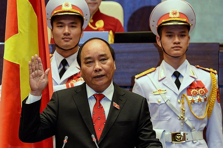 Prime Minister Nguyen Xuan Phuc being sworn in at Parliament House in Hanoi yesterday.