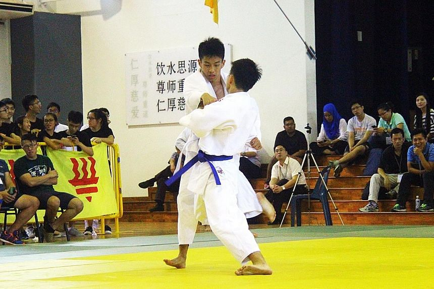 Jiang Zixing (facing camera) going up against team-mate Tseng Chen Yu in their extra-lightweight bout.