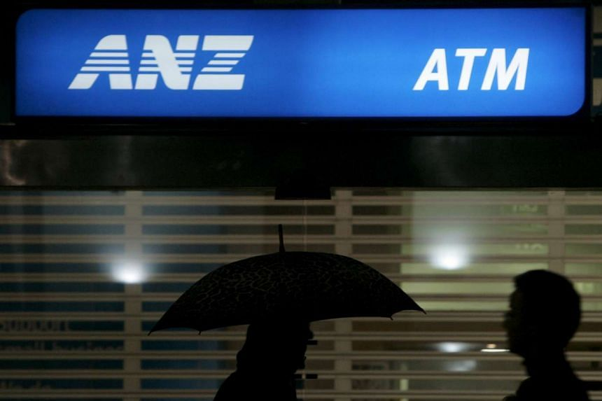 Office workers pass an ANZ Bank sign in central Sydney in this April 24, 2008 file photo.