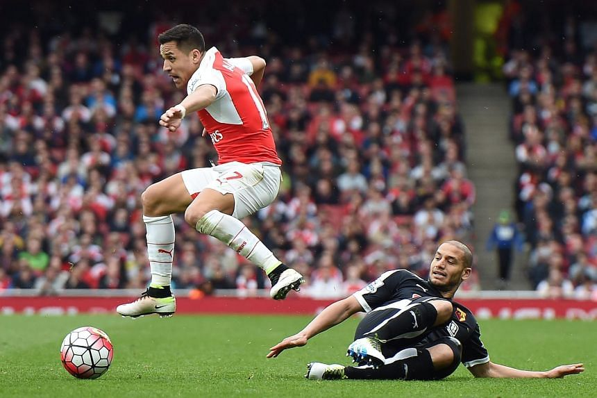 Arsenal's Alexis Sanchez (left) skips past Watford's Adelene Guedioura during an English Premier League match, on April 2, 2016.