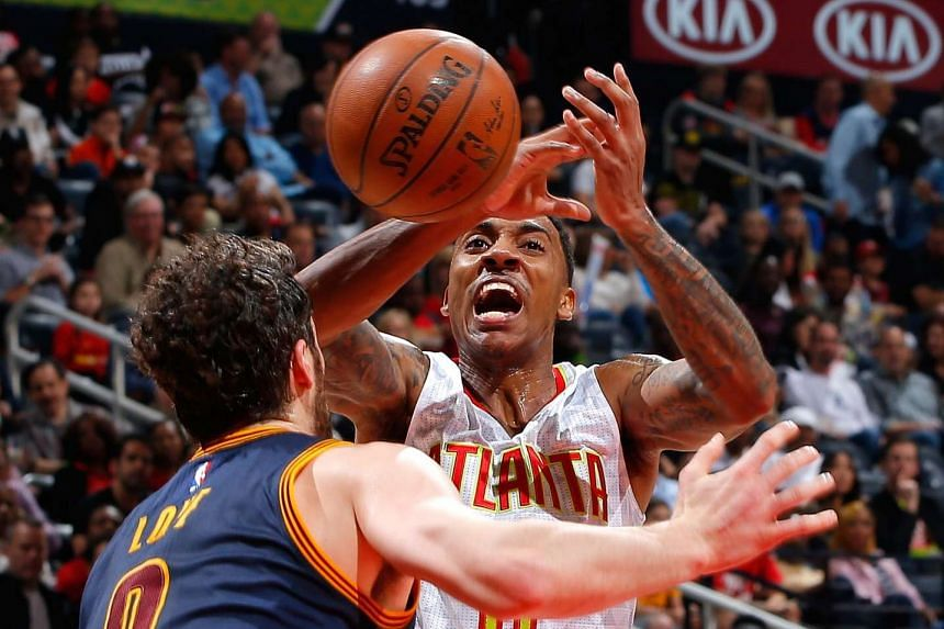 Jeff Teague #0 of the Atlanta Hawks loses the ball as he drives against Kevin Love #0 of the Cleveland Cavaliers at Philips Arena on April 1, 2016.