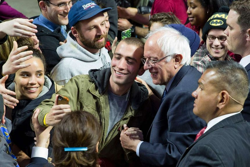 Sanders poses for a selfie with a supporter after addressing a campaign rally in Philadelphia, Pennsylvania, on April 6, 2016.