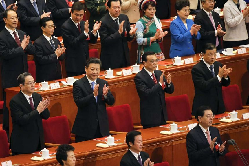 Members of China's powerful Politburo Standing Committee at the National People's Congress in Beijing on March 16.