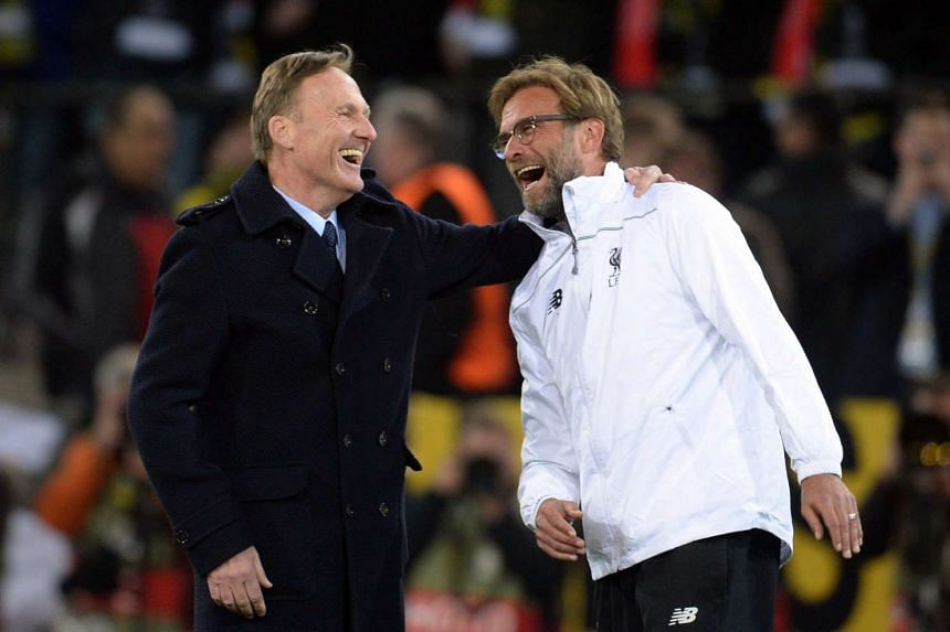 Borussia Dortmund chief executive Hans-Joachim Watzke (left) welcomes Liverpool's head coach Juergen Klopp prior to the match.