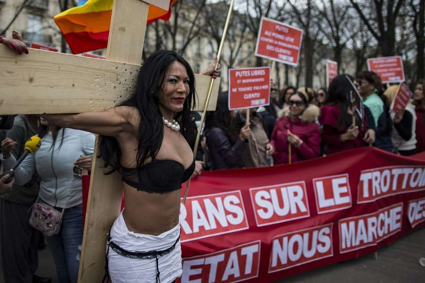 Transgender sex workers protest against a parliamentary vote to enforce the penalisation of solicitation on April 6, 2016.