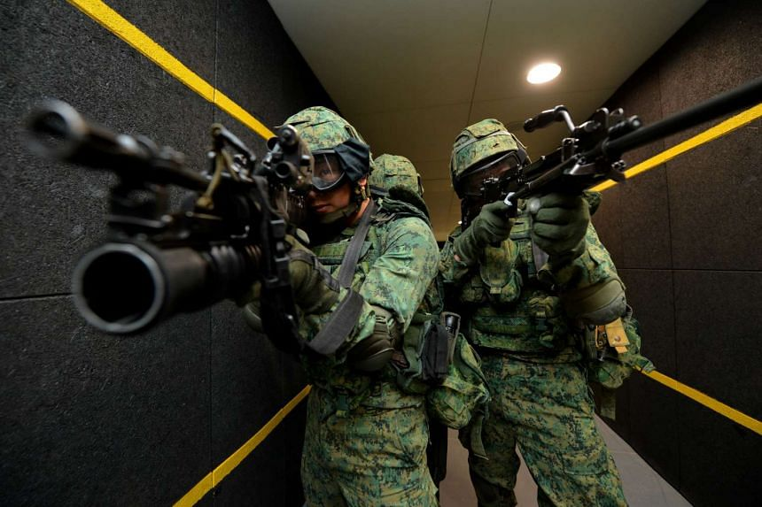 Soldiers from the Singapore Armed Forces (SAF) undergoing training at the Multi-Mission Range Complex, an indoor live-firing range.