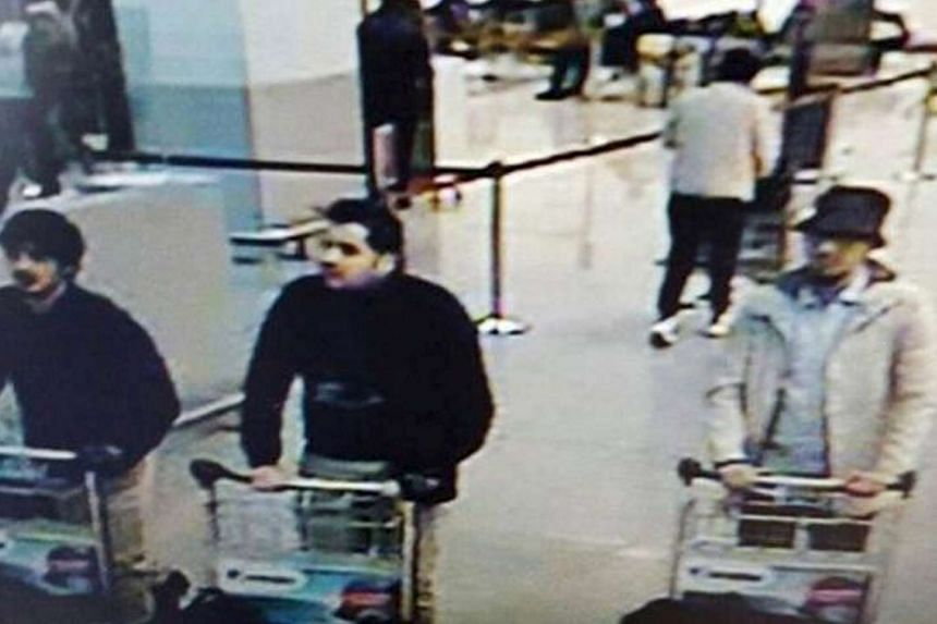 """Abrini is thought to be the """"man in the hat"""" (right) seen on security camera footage at Brussels airport."""