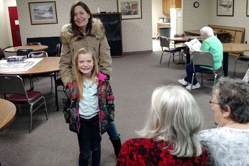 Nine-year-old reporter Hilde Kate Lysiak at a visit to Stayman Park Apartments in Shamokin Dam.