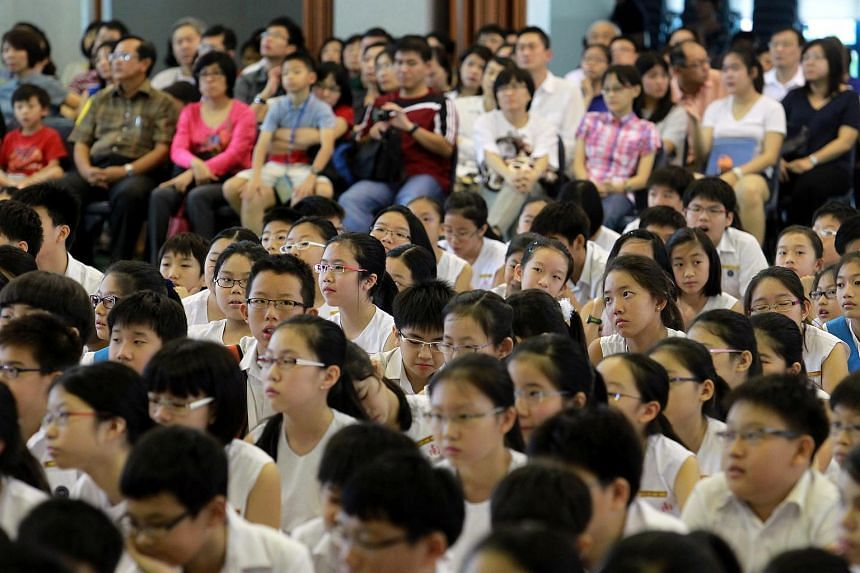 Pupils and parents awaiting the PSLE 2012 results at Nanyang Primary School.