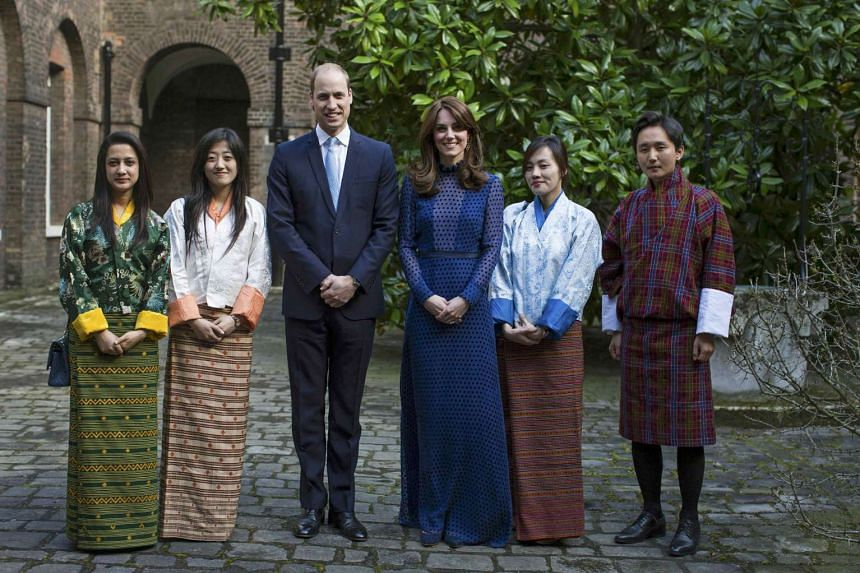 Britain's Prince William (third from left) and his wife Catherine, Duchess of Cambridge, attending a reception for young people from India and Bhutan, at Kensington Palace in London, Britain, on April 6, 2016.