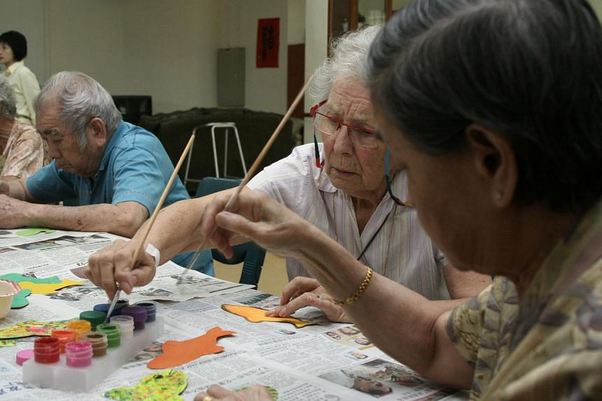 Seniors at Yong-En Care Centre enjoy an art and craft session.