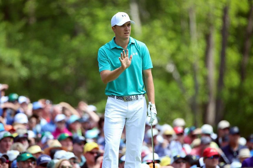 Spieth reacts to his shot from the 12th tee during the first round.