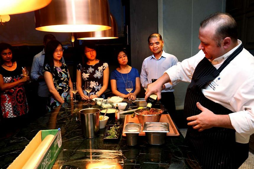 Diners watch award-winning French chef David Nicholas Senia in action at Capella Singapore in Sentosa.