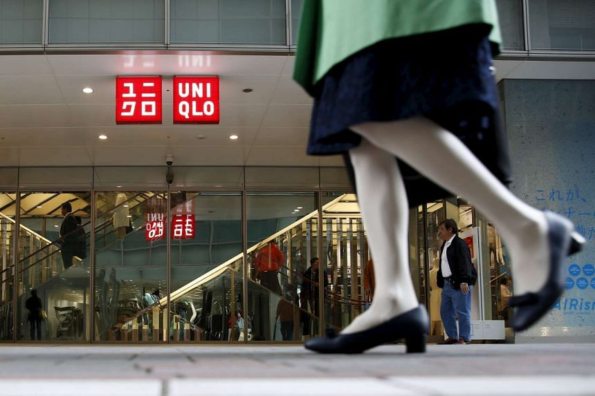 A pedestrian walks past a Uniqlo store in Tokyo, Japan, on April 6, 2016.