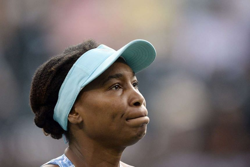 Williams (above) was toppled 7-6 (7/5), 2-6, 6-4 by Kazakhstan's Yulia Putintseva.