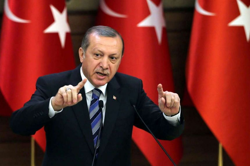 Turkish President Recep Tayyip Erdogan delivers a speech during a ceremony on the occasion of 171st anniversary of foundation of the Turkish National Police at the Presidential Complex in Ankara, on April 7, 2016.