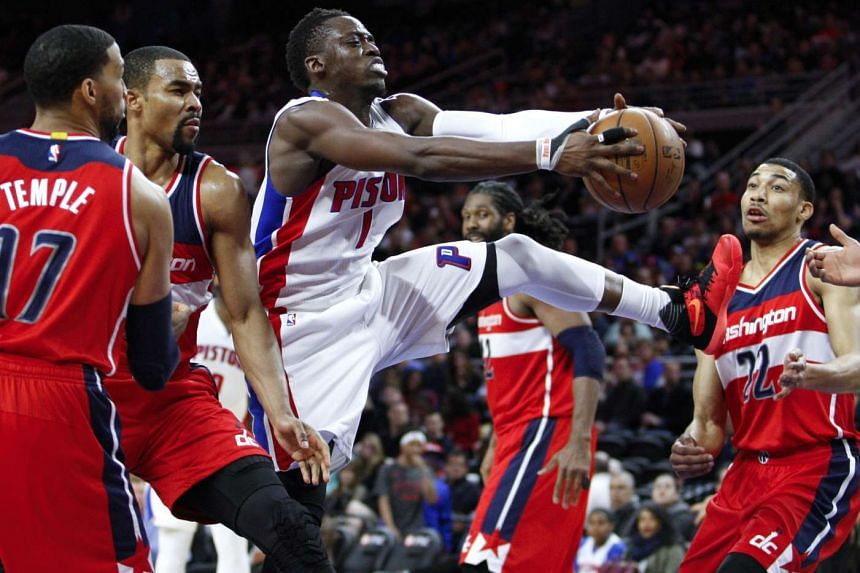 Detroit Pistons guard Reggie Jackson (third from left) gets control of the ball against the Washington Wizards.