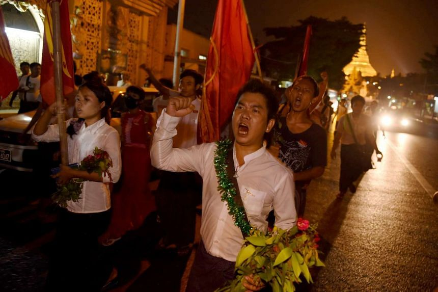 Freed students and supporters march from Shwedagon pagoda to a memorial hall upon their arrival in Yangon, on April 8.