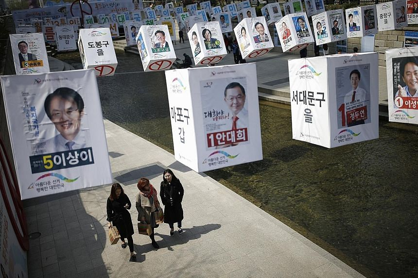 Posters of candidates for the parliamentary elections in central Seoul. Expected low turnout at the polls next Wednesday is likely to work to the advantage of President Park's ruling Saenuri Party.